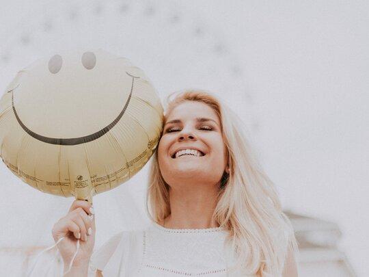 Weer met een glimlach naar je werk? Spar eens met een loopbaancoach!